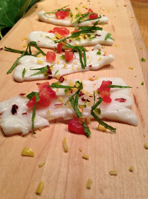Crudo may be served family style or laid out on a serving piece