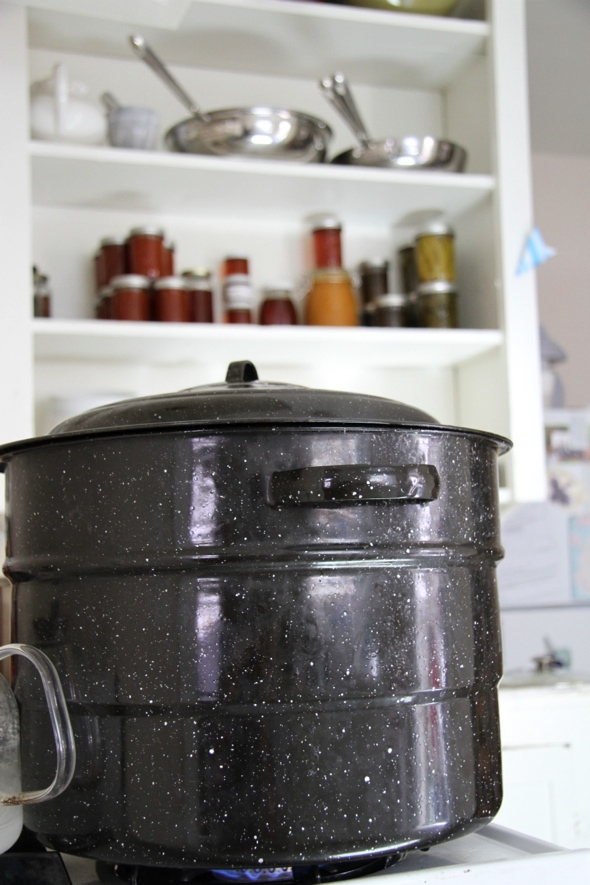 boiling jars in black pot